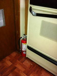 fire extinguisher by the oven