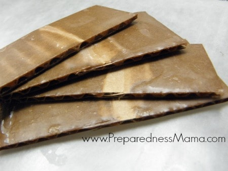 Pieces of cardboard dipped in wax are useful as DIY Fire Starters | PreparednessMama