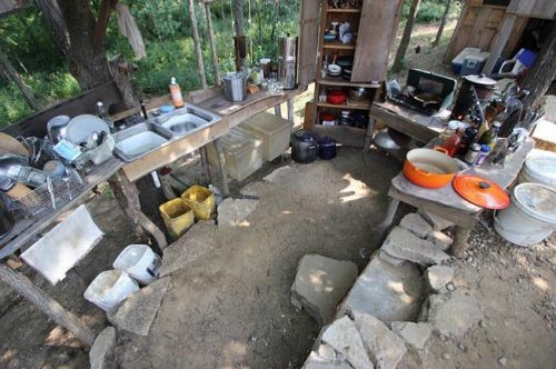 Teri's Outdoor Kitchen - perfect for cooking on a hot day from Creating Your Off-Grid Homestead by Teri Page   PreparednessMama