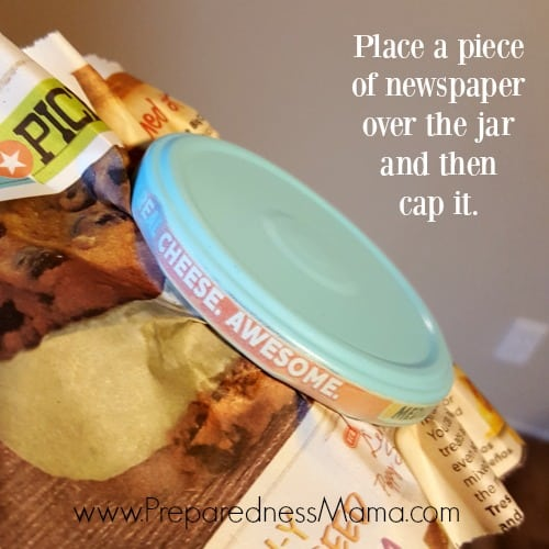If you missed a strip on the side of the lid here's the fix. Place a piece of newspaper over the repurposed glass jar and cap it/ The newspaper will protect overspray as you get the last area | PreparednessMama