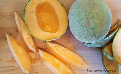 Cutting cantaloupe for dehydrating | PreparednessMama