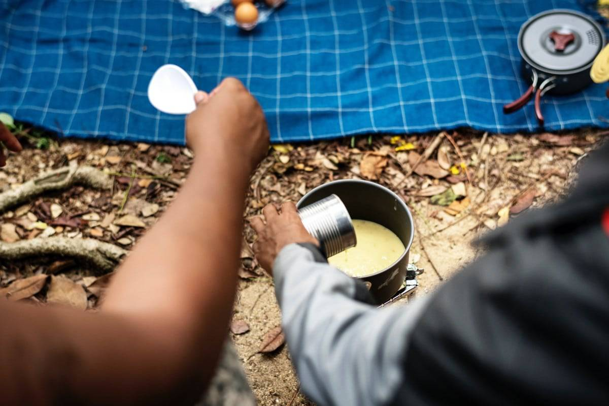 a camper cooking soup contained in the #10 can