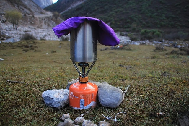 camping stove used to boil water, one of the best ways on how to purify water