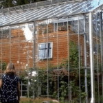 Couple Builds Greenhouse Around Home to Stay Warm and Grow Food All Year Long