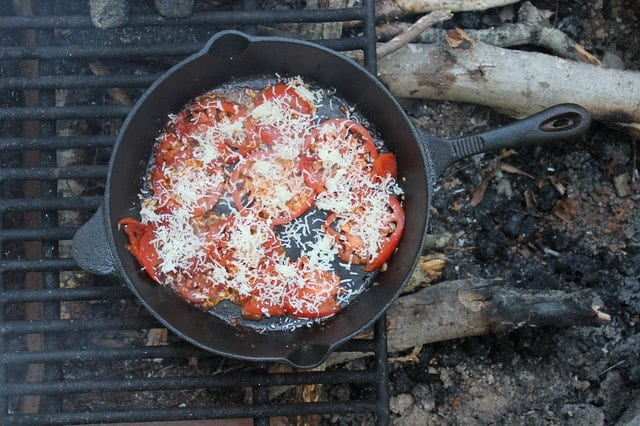 cast iron skillet over a grill