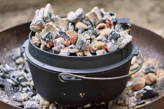 dutch oven pot with hot charcoal on top