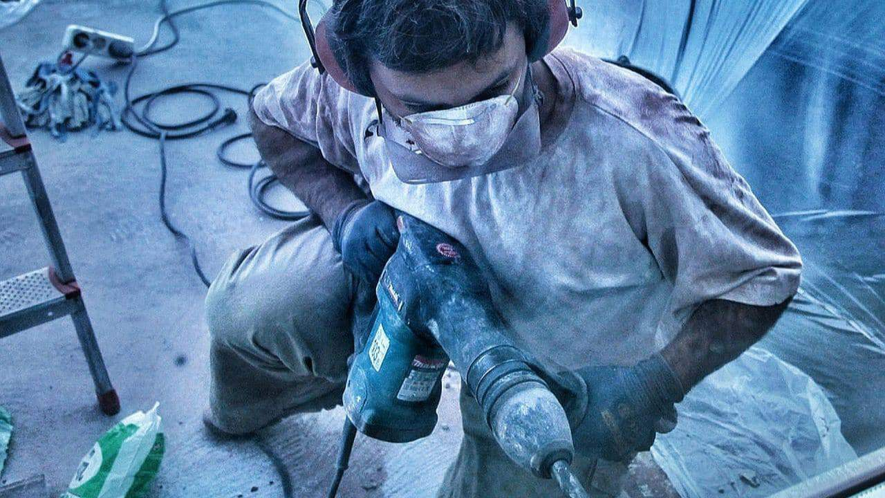 worker using hammer drill